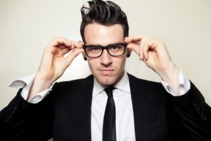 Young Businessman holding black glasses